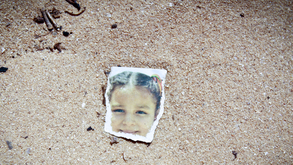 """Tunisia, Shousha camp. A photo found among the fire debris"""