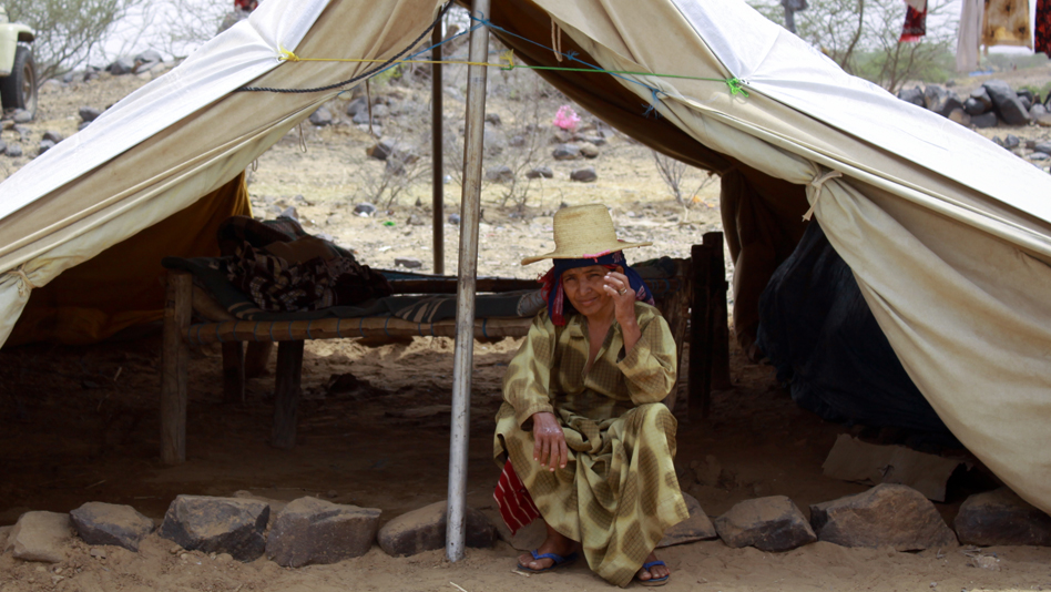 """Yemen, Hajjah. Displaced woman living in a spontaneous settlement"""