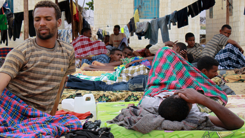 """Yemen, Ahwar Recetion Centre. Ethiopian new arrivals resting after a long journey across the Gulf of Aden"""